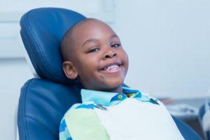 Smiling boy waiting for a dental exam