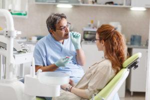 Dentist talking to patient about sleep apnea treatment
