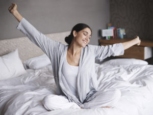 Woman waking feeling refreshed