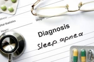a piece of paper with the diagnosis of sleep apnea written on it along with medication, a stethoscope, and glasses